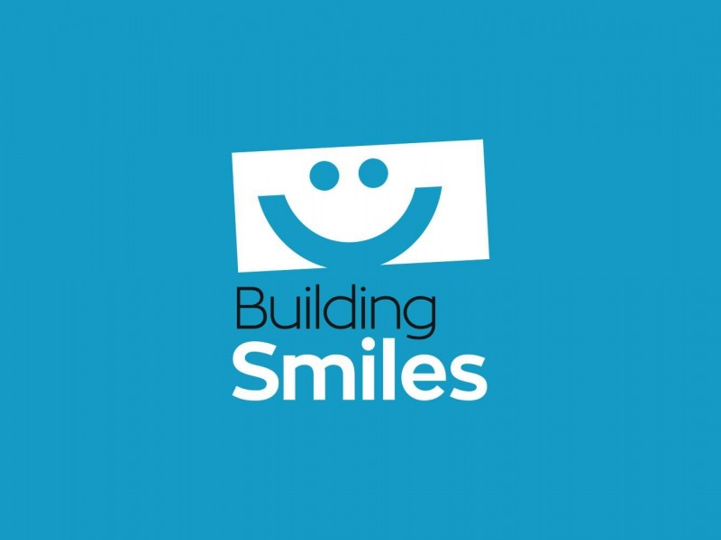 Master-Logos_Projects_Building-Smiles-Logo_Reverse
